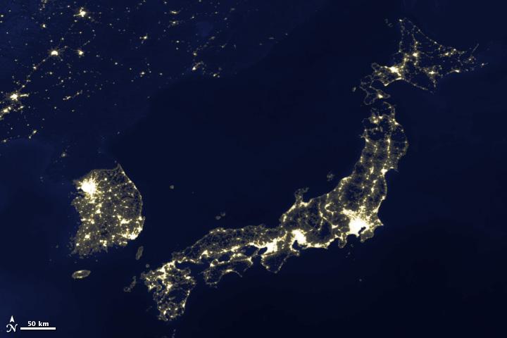 Image of Japan and Korea's city lights, 2003.